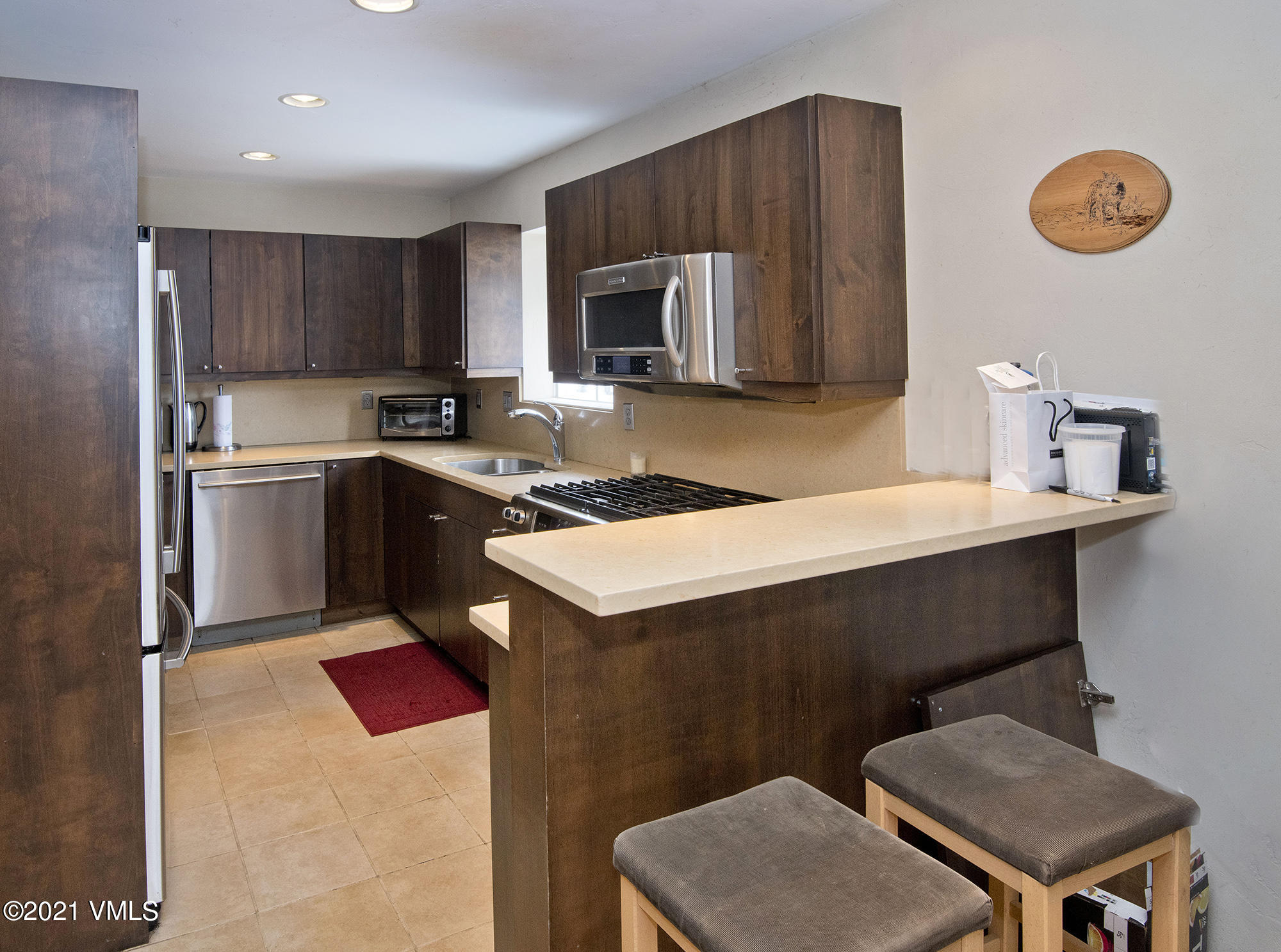 An end unit mostly remodeled with the ideal floorplan located in Homestead!  Upstairs bedrooms both en-suite, custom closets, and vaulted ceilings allowing for extra light and a great feel.  Basement is fully finished offering the 3rd bedroom area plus an additional living space & galley kitchen; currently used as a studio style lock-off (shared entrance). Fully remodeled kitchen with stainless appliances, newer counter tops and cabinetry. Tons of storage space.Owner has used as a rental property for years with no vacancy. Phenomenal investment opportunity with no short-term rental restrictions. The best location just steps to hiking trails, neighborhood parks, and the recently renovated Homestead Court Club. Walk to Edwards/Brewery/Post office.Accepting offers until Tuesday 4/20 6pm MDT. Seller will respond by Wednesday 4/21 6pm MDT.
