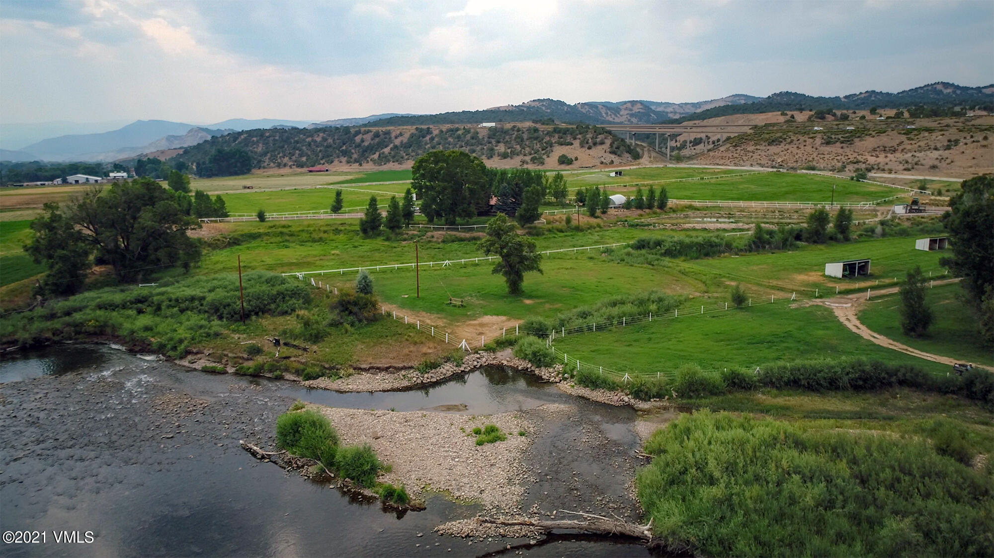This Stunning Ranch property is located in Eagle, Co. with space and amenities for multiple horses, or just simply enjoy the privacy of your property in this Gated Community. The home on the property is south facing, grab a cup of coffee and watch the sunrise along side your own Private Stretch of the Eagle River. Offering 35 acres, with world class fishing out your front door, 11 Fully irrigated and fenced lush green pastures, outdoor arena, round pen, several out buildings, and water rights! Ride out of your back door and explore endless trails with direct access to BLM Land. This property is 100% usable land, and produces over 15 tons of Hay per year. Including a cozy and quaint updated Single Family Home, with a lock-off, or caretakers unit. This property is located just off of Highway 6, and is in a prime location with Quick and easy access to I-70, downtown eagle, or just 30 minutes to Glenwood Springs, Beaver Creek or Vail for world class skiing all while in a tranquil and private setting. Eagle has grown into a beautiful town and a great community fill with Golfing, Mountain Biking, Hiking, Bike Paths, Local Events and Entertainment. Costco just 5 minutes down the road, and plenty of restaurants 10 minutes away if you enjoy a night out every now and then. Rarely does such a gem come to the market!