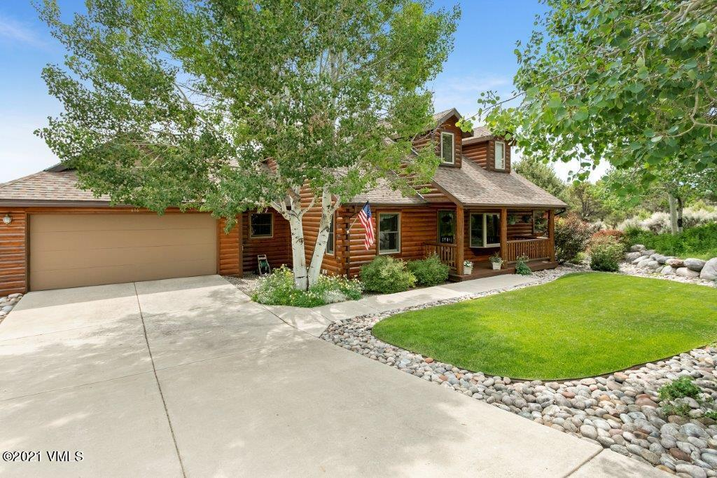 First time ever on the market this beautiful home in Eby Creek Mesa with 1.17 acres, offers a main floor master suite, 13 ft. vaulted ceilings, 2 full-size 2-car garages (4 cars total) and a large deck with breathtaking views of the Sawatch Range and Castle Peak.  The main floor offers a formal dining room, open living room with gas fireplace, stainless steel kitchen appliances, and breakfast nook, main floor laundry room with utility tub and powder room.  The lower level includes 2 bedrooms, a full bath, a walk-out family room that opens  to a covered patio, and a beautifully landscaped yard.  In-floor radiant heat throughout the house and both garages.  The lower level could easily be converted to a mother-in-law or secondary master suite could be added, as plumbing is already roughed in. The property includes adjoining lots A -134 (with the home) and A-135. Eagle County offers tax incentives for adjoining property or new owners can divide.