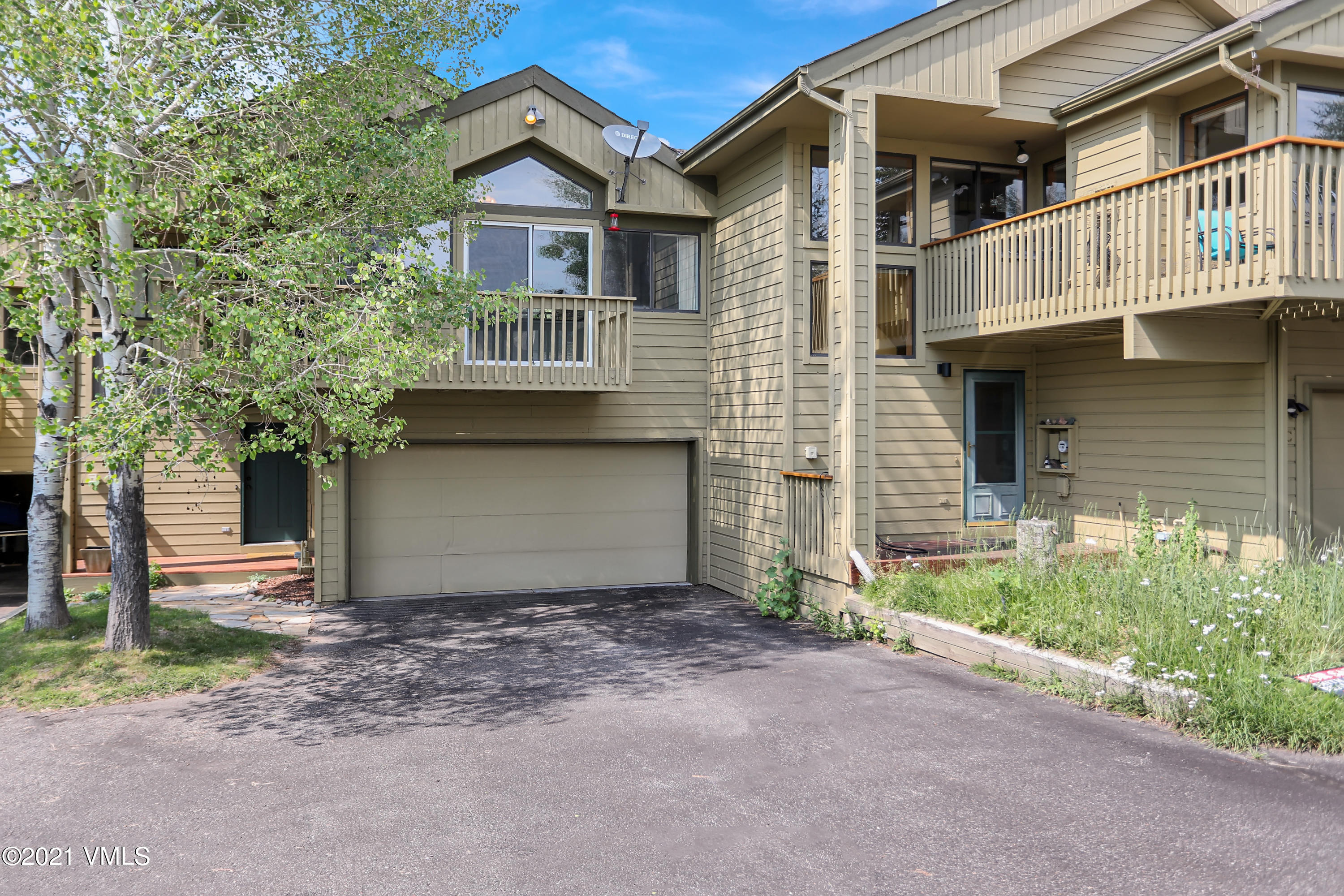 Come home to this beautiful, quiet oasis just minutes from I-70, Avon, and Beaver Creek Resort.  Enjoy gorgeous views from the living room and front deck, or relax in a hammock in your private aspen grove in the back yard. Plenty of room for all your toys in the 2 car garage and bonus storage area off the back of the garage. Top floor features open kitchen, living room & dining area as well as the master bedroom with ensuite bath. Middle floor has 2 bedrooms and a full bath, as well as access to the garage and back patio.  Basement level is a large bonus space with lots of potential uses and has it's own exterior entrance from the back yard.