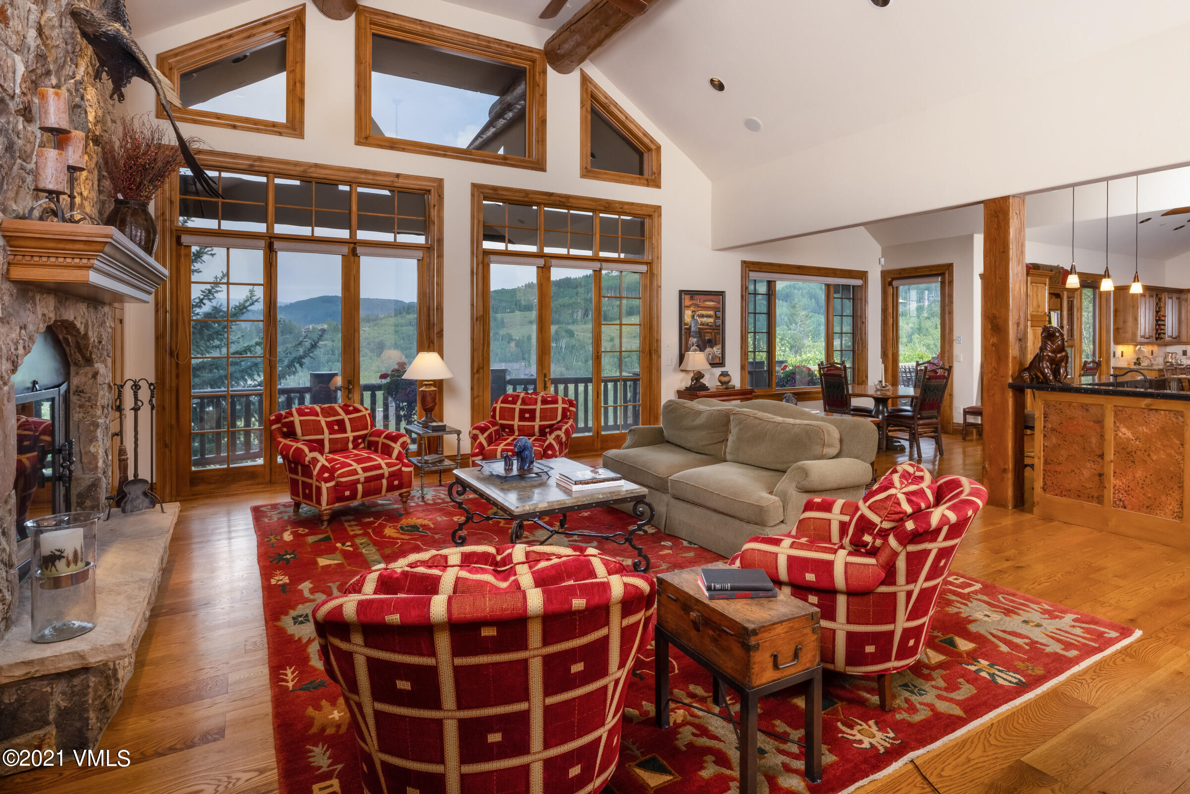 Opportunity to own a lovely home low on the mountain, lower elevation, and one of the closest single-family residences to The Ritz-Carlton(r) with a very comfortable and easy flowing floor plan. Perfect ski-in/ski-out to the back door via the maintained Ridge Rider Ski-Way. Dramatic and envied, easterly views of the Gore Range to watch those glorious mountain sunrises as well as the full moon lighting up the entire valley in front of you. You are greeted when you enter the home with a wonderful great room with soaring vaulted ceilings, large fireplace and log accents all directing you to the incredible views outside the large expansive windows. Main level primary suite with adjoining office; spacious bath and over-sized closet. First level offers a large stone deck and fire pit, all facing the ski slopes along with a built-in bar, separate dining room and den.  All guest bedrooms have en-suite baths with walk-in closets. Gracious sized lower level with ultra-high ceilings, family room with a bar and stone fireplace. Additional game room and ski room perfect for getting ready to enjoy the slopes. Lower-level patio includes a private hot tub. Two laundry rooms, 3-car garage. The winning combination of attributes all within this very exclusive, private, and secure resort just a short walk or minutes away from all the wonderful restaurants and luxuries of The Ritz-Carlton(r).