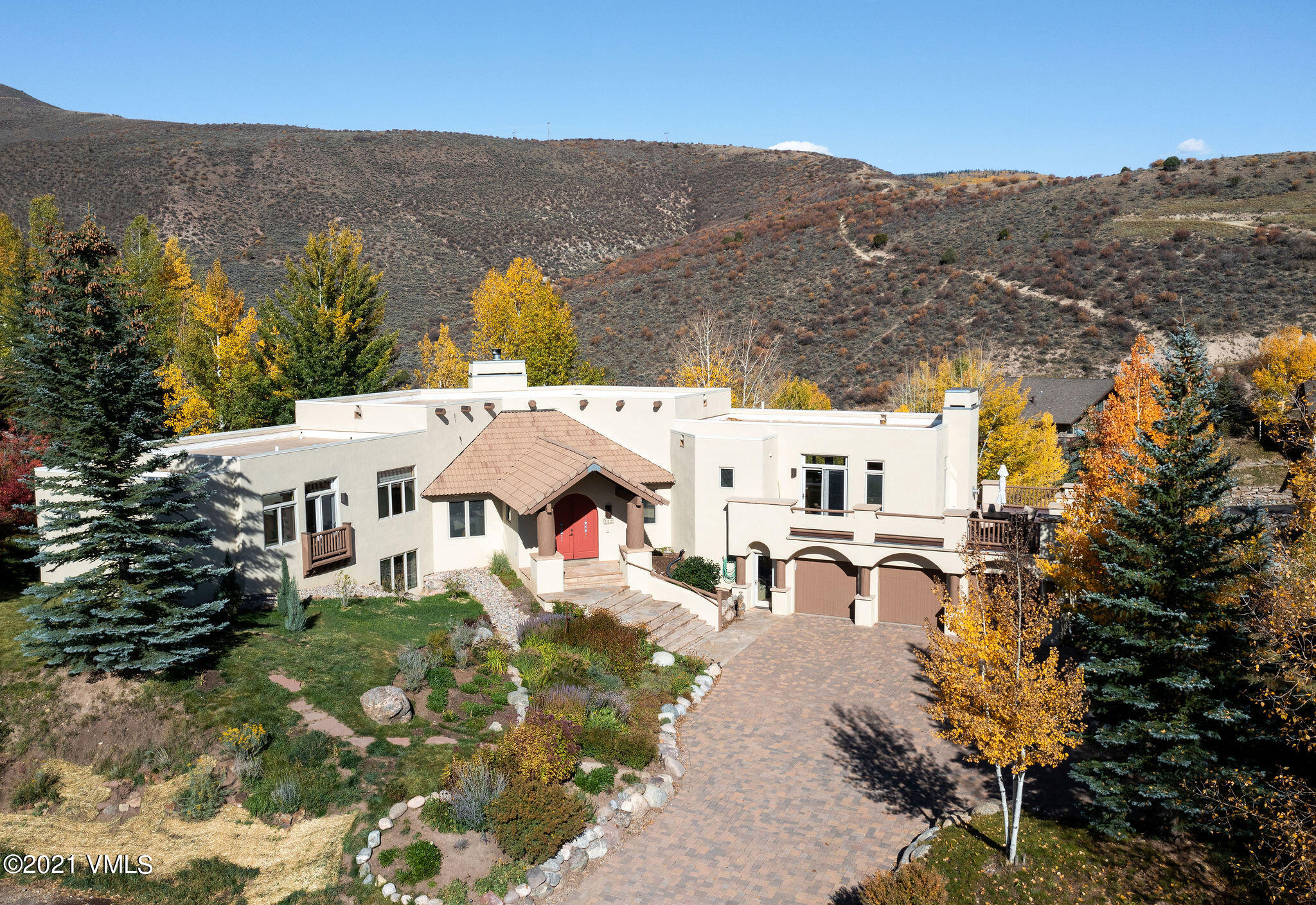 With panoramic views and a peaceful setting on a large homesite, this single-family home offers the best of Singletree.  Located at the end of a quiet street in the upper neighborhood, you will enjoy views of the Sawatch range, Arrowhead Mountain and surrounding beauty from both interior and multiple outdoor living areas.  A  flat paver inlaid driveway with space for several guests welcomes you and provides a warm and impressive sense of entry.  Through grand double front doors, a light-filled open floor plan greets you. The upper level has a living room, office opening to a private outdoor patio complete with hot tub and fire pit, a primary bedroom, dining, kitchen, hearth room and breakfast nook.  On the lower level, 3 guest rooms with en-suite baths, a family room plus game area and an exercise room await.  A mud room leading to a 3-car garage and plenty of storage throughout complete this thoughtful home.  Singletree is a community with an extensive hiking and biking trail system, club and community amenities, parks and close proximity to Edwards.  Minutes to schools, skiing, fishing, shops and restaurants.