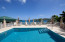 Enjoy the ocean breezes while relaxing poolside