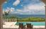Chaises overlook Mango Hill's 40' heated swimming pool and the Caribbean Sea beyond - Photo by Ted Davis