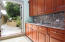 Thoughtfully designed, this pantry behing main kitchen, leads out to protected BBQ area