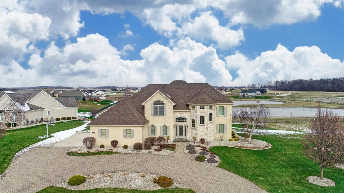 Welcome to 2203 Eaglebrooke Circle. This custom-built home has been taken care of with great pride. Walking in you will find open concept living with the family room & kitchen that allows for everyone to be together. The kitchen is lined with windows that overlook the pond. There is a cooktop, built-in microwave & oven, dishwasher & large island. Sit down to eat at the kitchen table, island or in the formal dining room. The master bedroom has tray ceiling plus a separate walk-out door to the deck overlooking the pond. Next is an en suite with a whirlpool tub, separate steam shower with seat, his & her vanities, & walk-in closet that has a door to the laundry room. The office is located on the 1st floor & can easily be converted into a 5th bedroom. Upstairs is a large loft / seating area & 2 bedrooms separated by a full bath. Don't forget the partially finished walk-out basement with bedroom, full bath & 2nd kitchen. Over 4,500 of finished living space here is waiting for new owners to make this home their own. Contact your favorite agent to schedule a private showing.