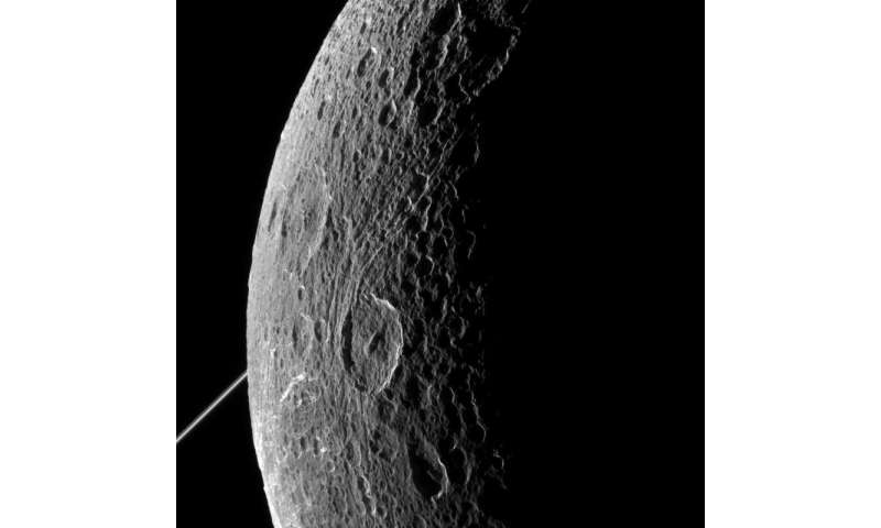 Cassini zooms past Dione