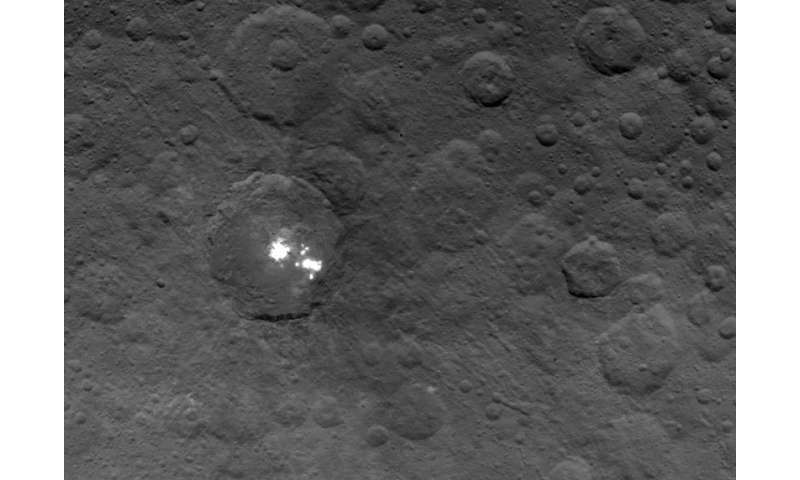 The brightest spots on Ceres are seen in this image taken by NASA's Dawn spacecraft on June 6, 2015. The picture was taken from an altitude of 2,700 miles (4,400 kilometers). Credit: NASA/JPL-Caltech/UCLA/MPS/DLR/IDA   Read more at: http://phys.org/news/2015-07-ceres-mysterious-bright-hazy.html#jCp