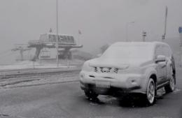 Snow and ice covering buildings and cars at Mount Hotham as snow fell in Australia
