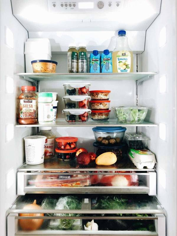 Organized fridge with food.