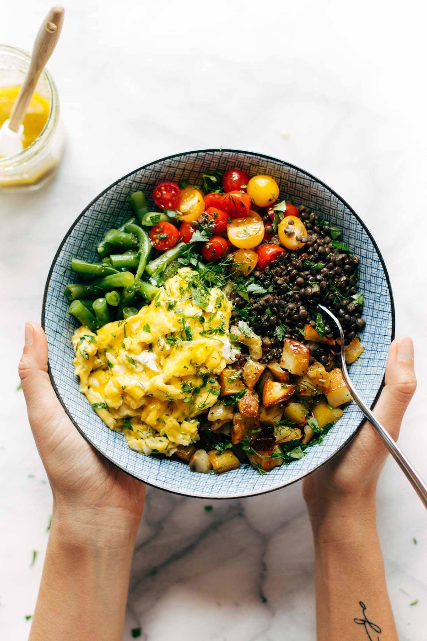 Sunshine Lentil Bowls for a summery clean eating reset! with garden produce like green beans, tomatoes, herbs, roasted potatoes, lentils, goat cheese, and soft scrambled eggs. Gluten free, vegetarian. | pinchofyum.com