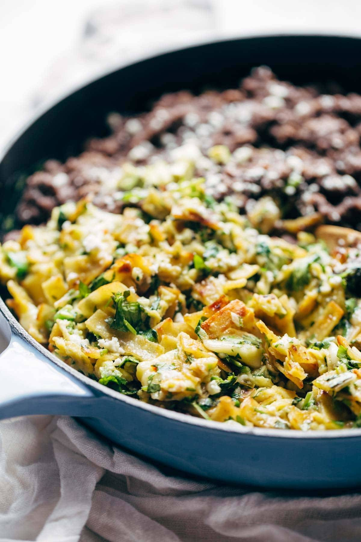 Migas - eggs scrambled with crispy tortillas, garlic, jalapeño, and melted cheese served with black beans and avocado. Quick, easy, and SO DELICIOUS. Breakfast, lunch, dinner, or brunch!   pinchofyum.com