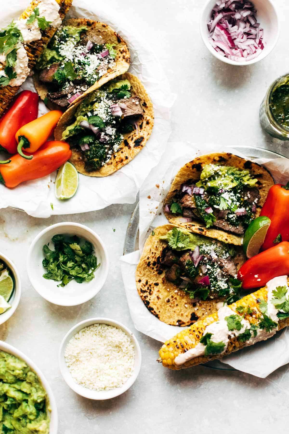 Chimichurri Steak Tacos - spicy marinated grilled steak, a quick chimi sauce, and all your other favorite toppings. Gluten free. | pinchofyum.com