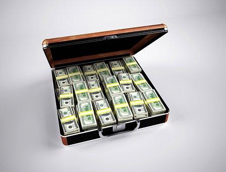 Wads of dollar bills stuffed into a briefcase