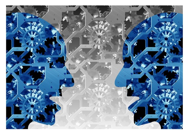 gears with silhouette of two heads facing each other