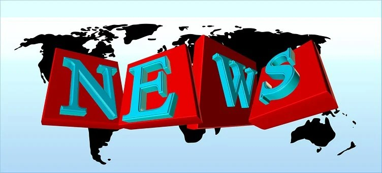 Map of the world in the background with the letters NEWS written on red squares arranged sideways