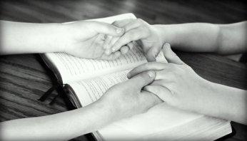 Holding Hands Bible Praying Friends Bible
