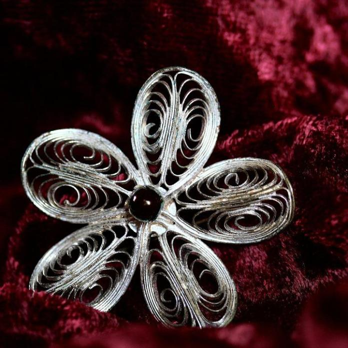 an ornate brooch can dress up an outfit