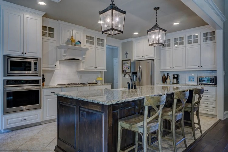 beautiful kitchen with white paint on cabinets