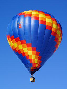 An image of a hot air balloon, high in the sky. This in regards to why an experience is more valuable than a possession.
