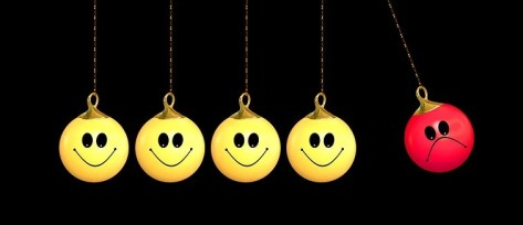 four yellow smiley emoji and beside red sad emoji pendant ornament illustration