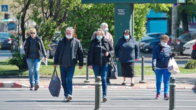 People wering face masks outside on the street
