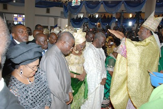 The Archbishop of Kafanchian,  Bishop  Joseph Bagobiri Prays for President Goodluck Jonathan, his Wife,  Chief Tony Anenih and his wife Dame Patricia Anenih  at the thanksgiving service