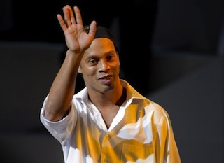 Brazilian footballer Ronaldinho waves before a conference at the National Auditorium in Mexico city