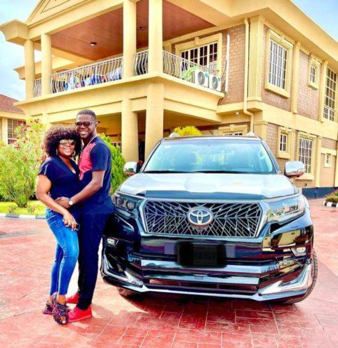 Funke Akindele and hubby JJC Skillz pose with his new SUV