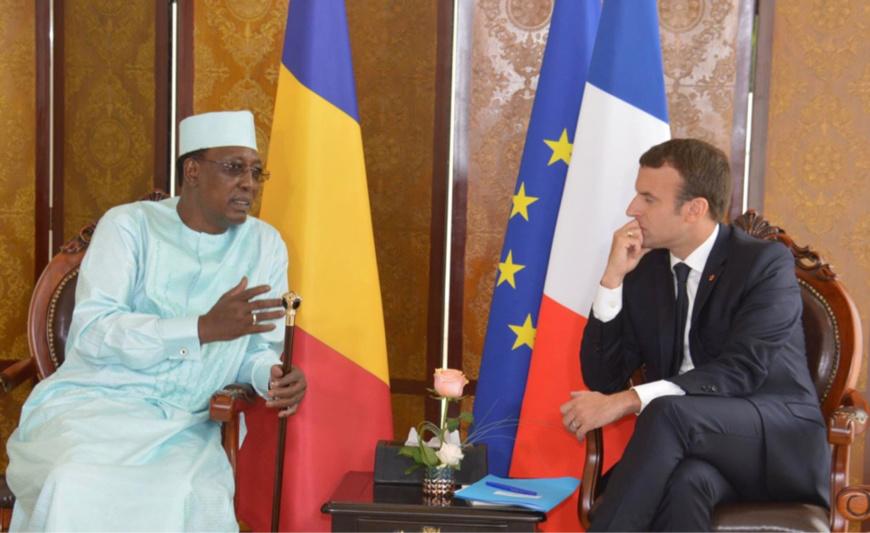 Macron, right and Idriss Deby