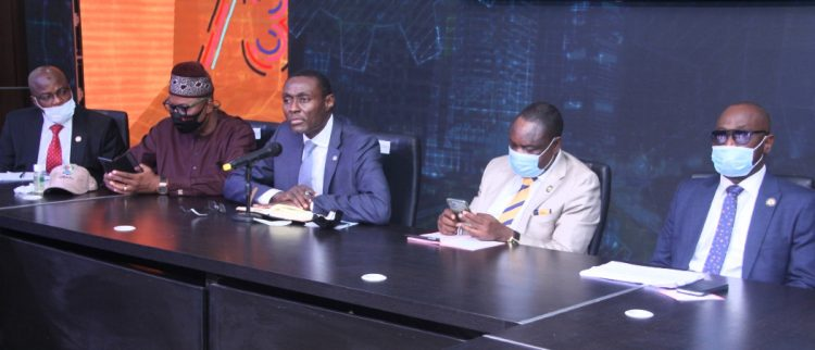 Dr. Frederic Oladeinde and other top government officials at the ministerial briefing