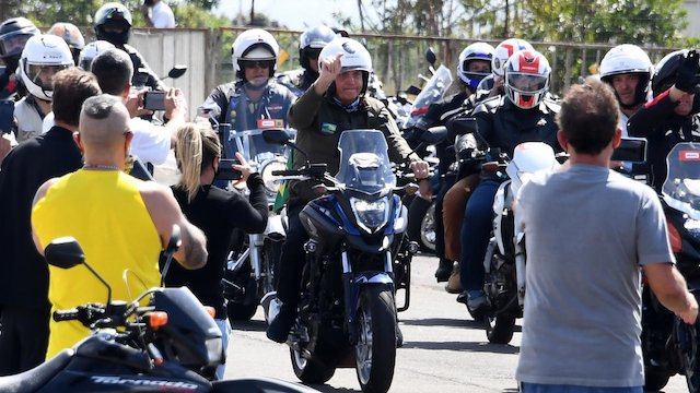 Bolsonaro, centre, leads Okada riders for a rally in Brasilia