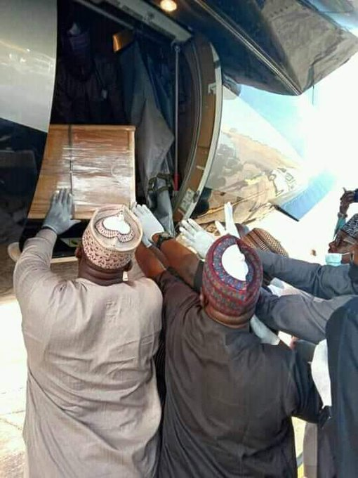 Mama Taraba's casket being removed from the plane in Jalingo
