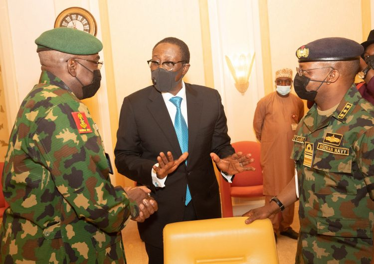 NSA Maj Gen Babagana Mongonu Confers with some service chiefs at the meeting. PHOTO; SUNDAY AGHAEZE.