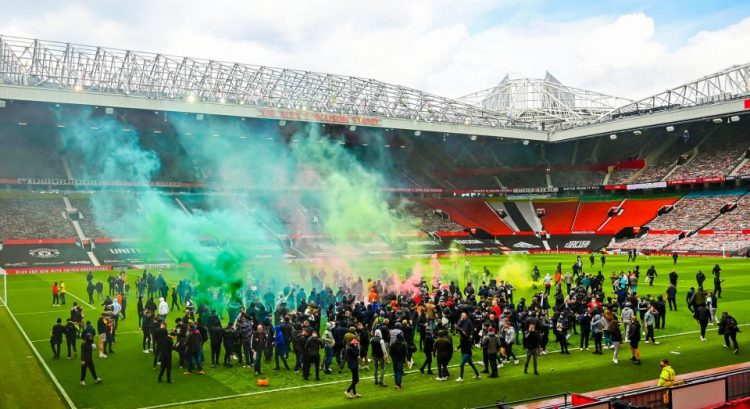Fans invade Old Trafford pitch