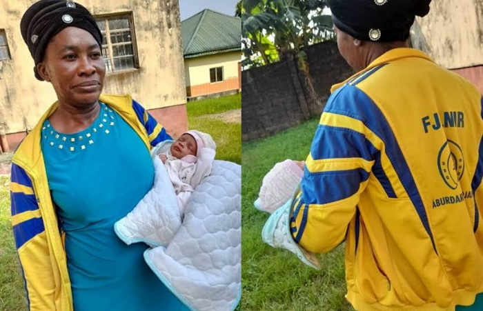 FILE PHOTO: The suspected child trafficker, Imabong Aniefiok-Samuel with the five-day-old baby boy arrested in Cross River.