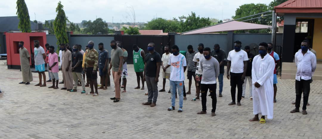 The suspects at EFCC's office in Ibadan