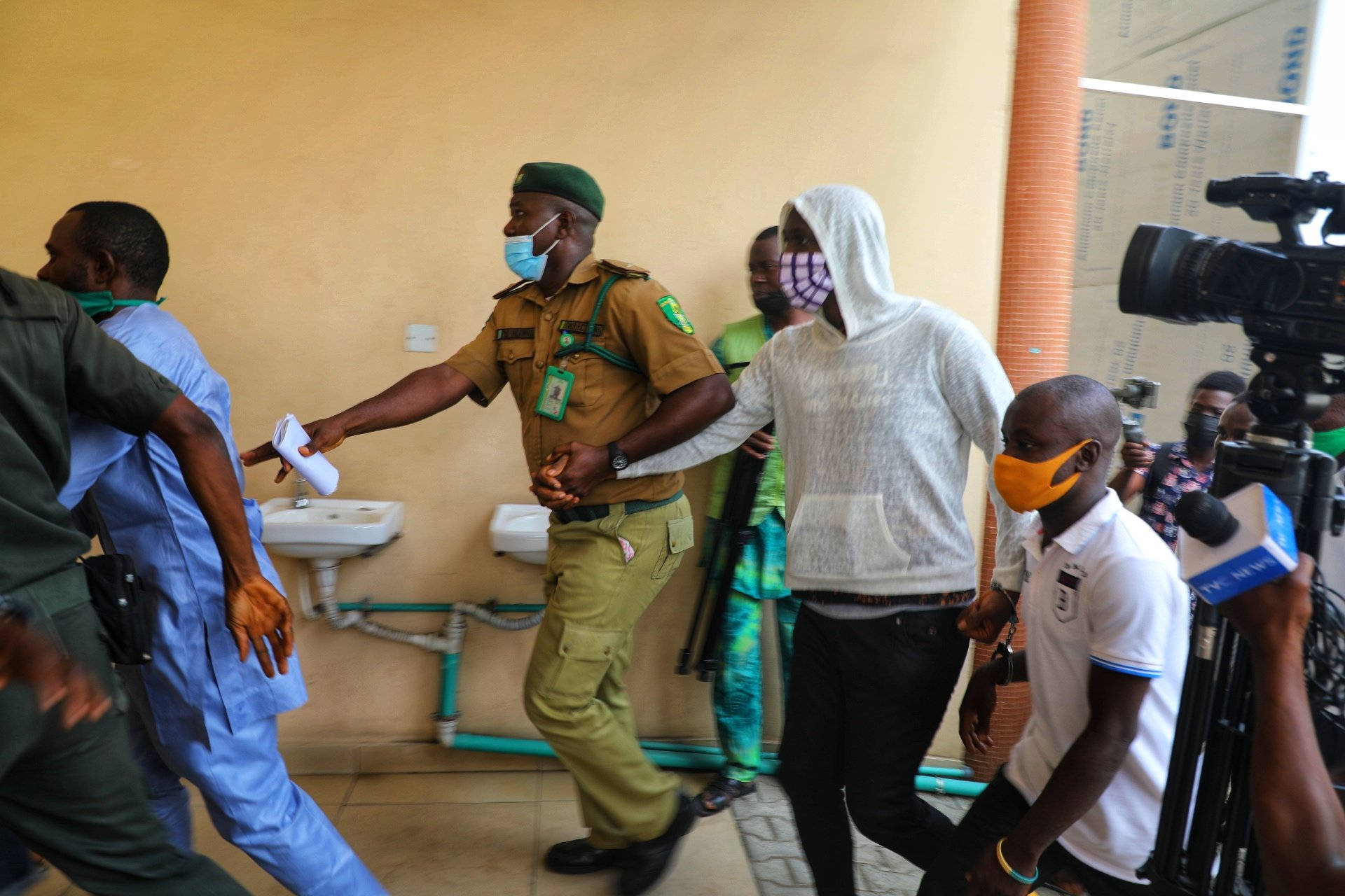 Baba Ijesha was dragged into the court by a prison warder to avoid pressmen and supporters