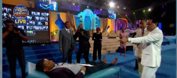 Pastor Chris ministering to a bedridden man who received healing afterwards