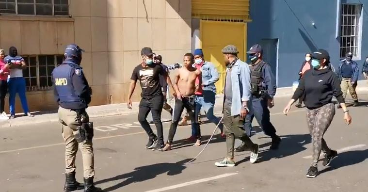 A rioter in South Africa being arrested by police in Johannesburg