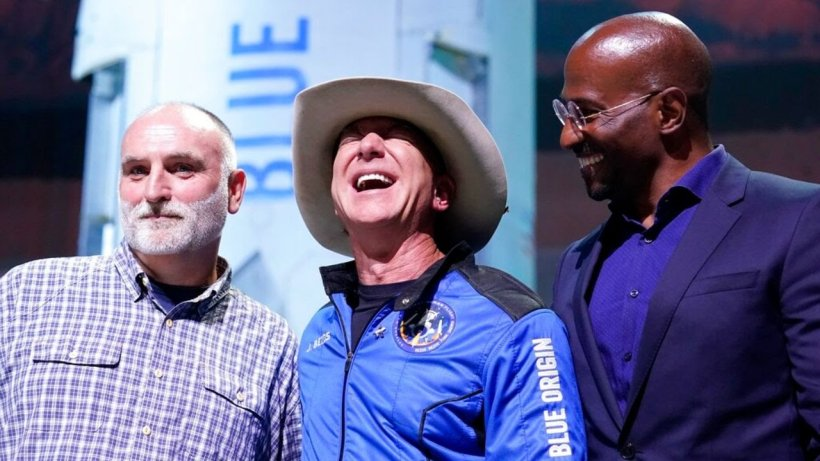 Jeff Bezos, middle, with Van Jones, right and Jose Andres