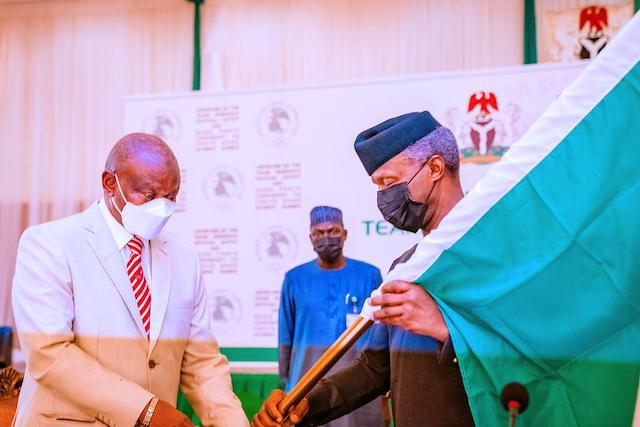 Vice President Yemi Osinbajo  hands over the national flag to Team Nigeria going for  2020 Tokyo  Olympic