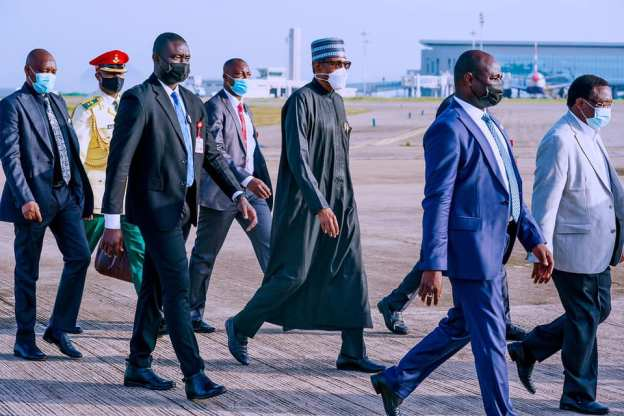 President Buhari makes his way to the Air Force One plane