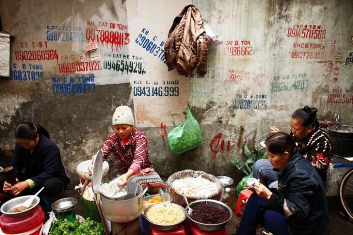 Traditional street food: women in Hanoi, Vietnam