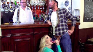 Keiran is talking with the bartender while Tamara Grace is sucking his cock Preview Image