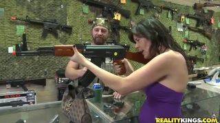 Hot brunette chic checking out some_awesome guns for protection Preview Image