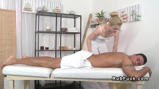 Oiled dude fucks his masseuse on a massage table Preview Image