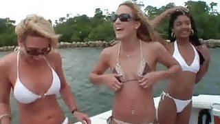 Amateur lesbian bikini babes have a playful orgy on a boat Preview Image