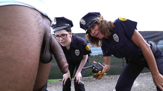 Cock hungry cops Lyla Lali and Norah Gold sucking giant black pole Preview Image