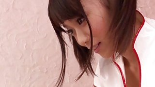 Adorable japanese nurse helps her patient_with his problem Preview Image